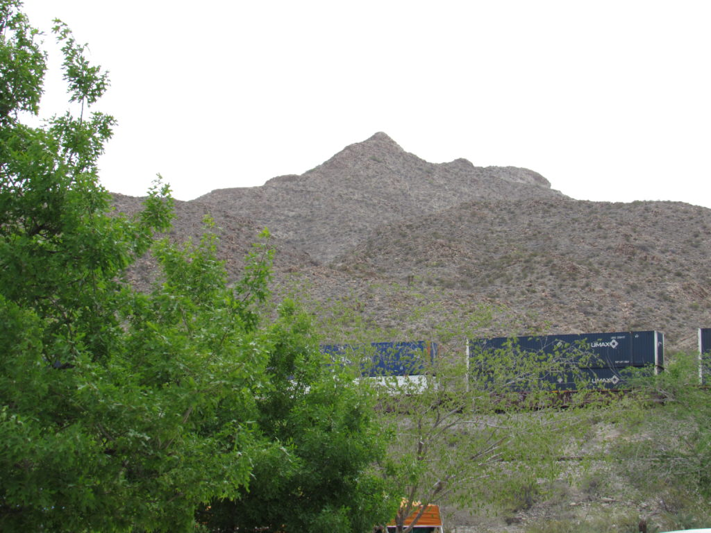 train winding around Mount Cristo Rey